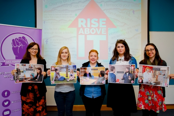 "Catherine O'Sullivan, UCC Lecturer, Daisy Pemble, Campaigns officer at UCC Feminist Society, Katie Quinlan, UCC SU Welfare Officer, Ellie Mahony, UCC Feminist Society and Sadhbh Corkery, UCC Feminist Committee member, pose with their posters as part of the UCC Feminist Society ""Rise Above It"" Campaign. UCC Feminist Society are encouraging students to rise above targeted online abuse with their new visual campaign, ""Rise Above It"". The campaign is both visually striking and thought-provoking and features feminists from the Cork area – including Mary Crilly of the Cork Sexual Violence Centre and Adam Finn, Entertainments Officer on the UCC Student Union. Photo by Emmet Curtin. FREE TO USE. REPRO FREE."