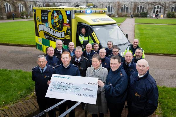 Members of UCC's Security Staff presenting a cheque for over €5,000 to Bumbleance, their chosen charity last year